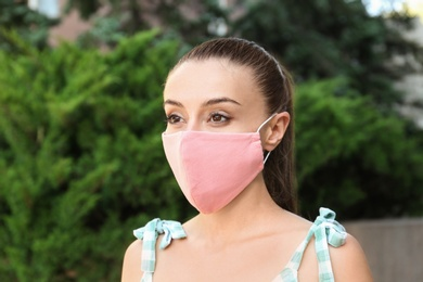 Woman wearing handmade cloth mask outdoors. Personal protective equipment during COVID-19 pandemic