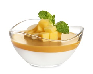 Delicious panna cotta with mango coulis isolated on white