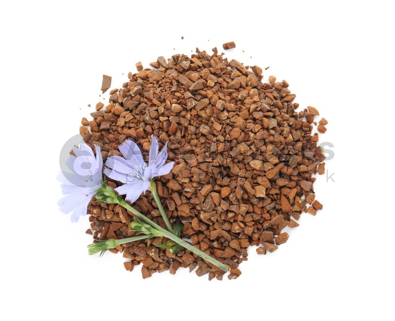 Pile of chicory granules and flowers on white background, top view