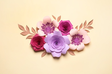 Different beautiful flowers and branches made of paper on beige background, flat lay