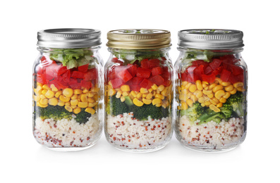 Glass jars with healthy meal isolated on white