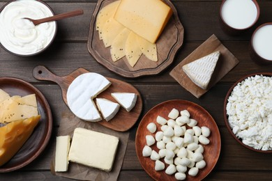 Flat lay composition with dairy products on wooden table