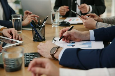 Businesspeople having meeting in office, closeup. Management consulting