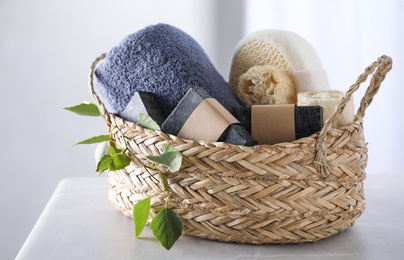 Natural tar soap in wicker basket on white table