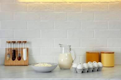 Different dairy products and eggs on countertop in modern kitchen