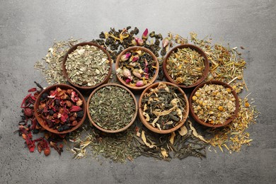 Flat lay composition with different dry teas on grey table