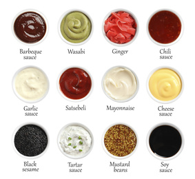Set of different delicious sauces and condiments with names on white background, top view
