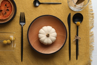 Autumn table setting with pumpkin on white background, flat lay
