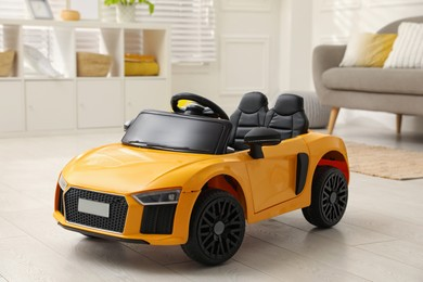 New yellow toy car in living room