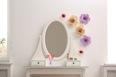 Stylish room interior with floral decor and dressing table