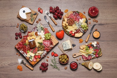 Assorted appetizers served on wooden table, flat lay