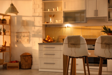 Modern kitchen interior with stylish wooden table. Space for text