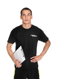 Portrait of personal trainer with clipboard on white background. Gym instructor