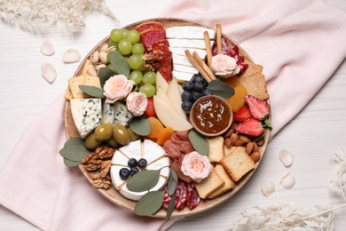 Assorted appetizers served on white wooden table, flat lay