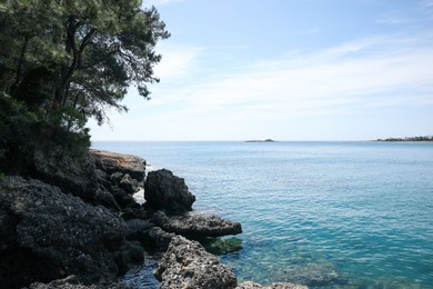 Beautiful view of rocky sea coast on summer day