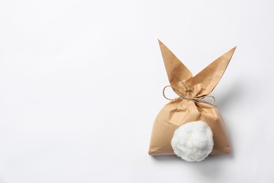 Creative Easter bunny gift bag on white background, top view