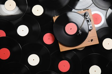 Modern player on vintage vinyl records, top view