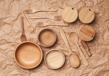 Set of modern cooking utensils on brown parchment, flat lay