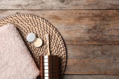 Flat lay composition with bamboo toothbrush and space for text on wooden background