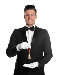 Handsome butler holding hand bell on white background