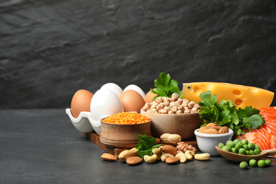 Different products rich in protein on black table