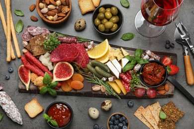 Set of different delicious appetizers served on grey table, flat lay