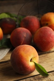 Fresh ripe juicy peaches on wooden table, closeup