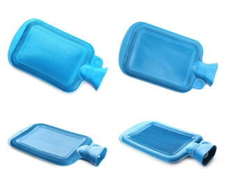 Set with blue rubber hot water bottles on white background