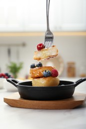 Delicious cottage cheese pancakes with fresh berries and honey served on white table