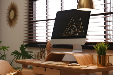 Stylish workplace with modern PC on table at window. Ideas for interior design