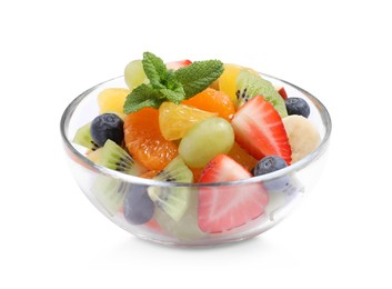 Delicious fresh fruit salad in glass bowl on white background