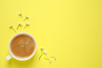 White flowers and coffee on yellow background, flat lay with space for text. Good morning