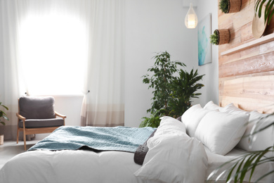 Cozy bedroom decorated with green plants. Home design ideas
