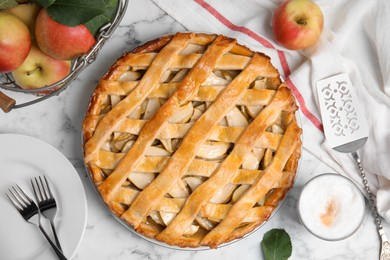 Delicious traditional apple pie on white marble table, flat lay
