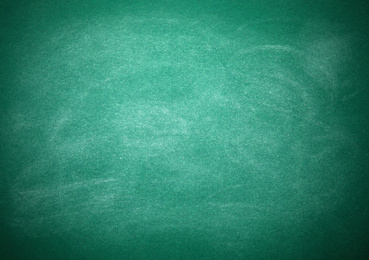 Chalk rubbed out on green board as background. Space for text