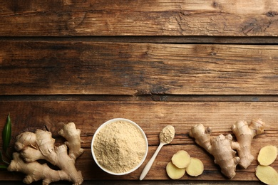 Dry ginger powder and fresh root on wooden table, flat lay. Space for text