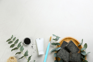 Flat lay composition of toothbrush with natural bristles on white table. Space for text