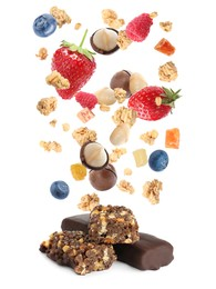 Tasty protein bars and granola with berries and nuts falling on white background
