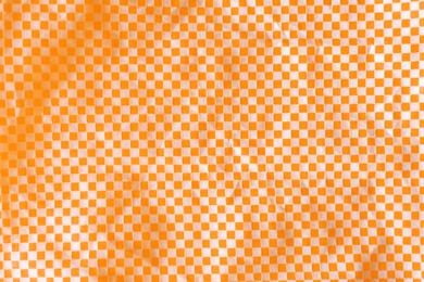Texture of orange and white checkered fabric as background, top view