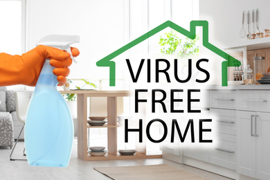Keep your home virus-free. Woman cleaning kitchen with disinfecting solution