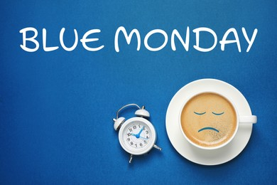Cup of coffee, alarm clock and text Blue Monday on color background, flat lay