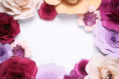 Frame of beautiful paper flowers on white background, flat lay. Space for text