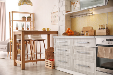 Modern kitchen interior with stylish wooden table