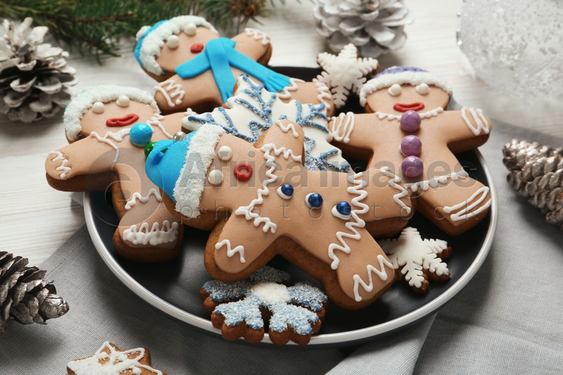 Delicious Christmas cookies and pine cones on table, closeup