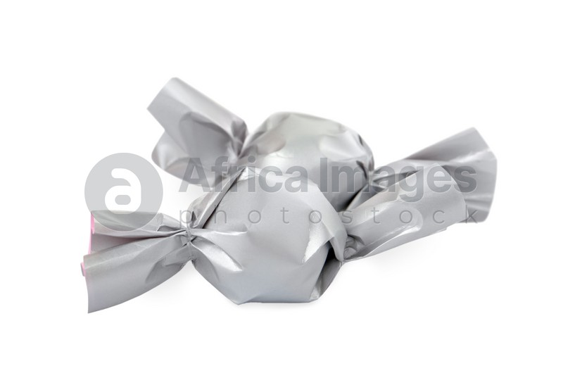 Delicious candies in silver wrappers isolated on white