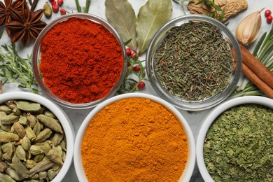 Flat lay composition with different natural spices and herbs on table