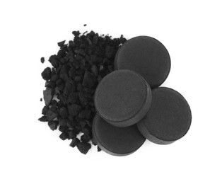 Activated charcoal on white background, top view. Potent sorbent