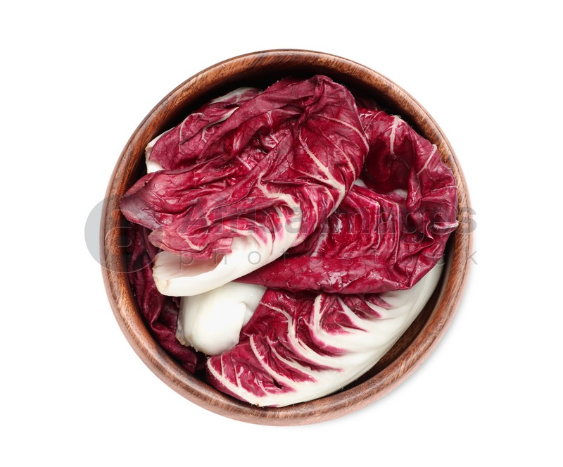 Leaves of ripe radicchio in bowl on white background, top view