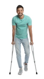Full length portrait of man with crutches on white background