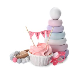 Baby shower cupcake with Girl topper near pacifier and toys on white background